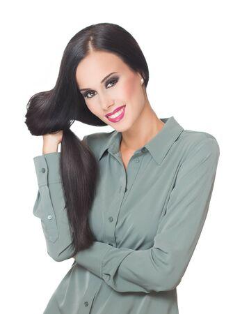 Portrait of a brunette beauty showing off amazing long hair.