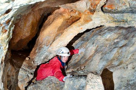 Caver exploring the cave