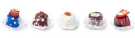 Collection of images: Pieces of bananas covered with white, dark and color chocolate with coconut flakes and nuts designed as a candy on the white background