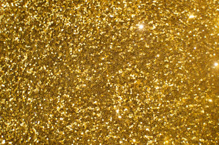Abstract background with glittering golden particles