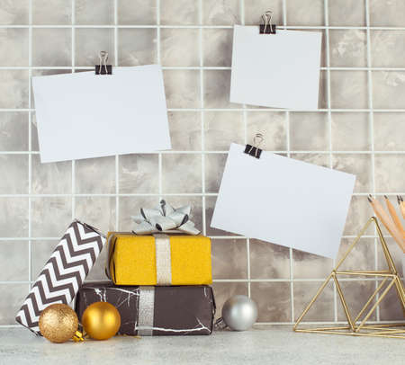Mood board with empty cards on it near gift boxes. Blank space for text. Stock Photo