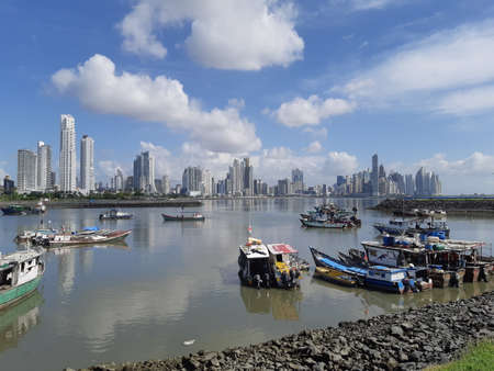 Skyline of Panama city downtown with high rise buildings and harbour with old wooden boats in front. Panama city, Panama.
