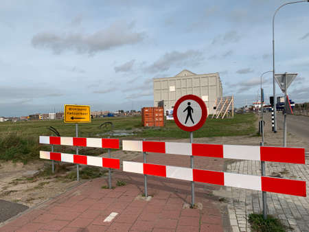 Barriers and signs to indicate closed bike lane and sidewalk. Road work ahead. Detour for bicycles. Pedestrians not allowed. No access. Vlissingem, Zeeland, Netherlands.