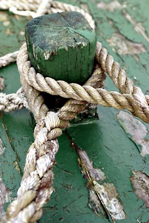 green boat: Ropes on a green boat.