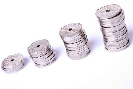 profiting: Stacks of Norwegian coins on white background. Stock Photo