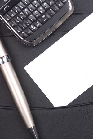 businesscard: Businesscard and phone on a black leather folder