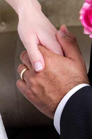 Newly wed couple holding hands and showing their love. photo
