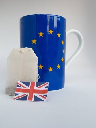 Cup with european flag and teabag with British flag, isolated on white background Imagens