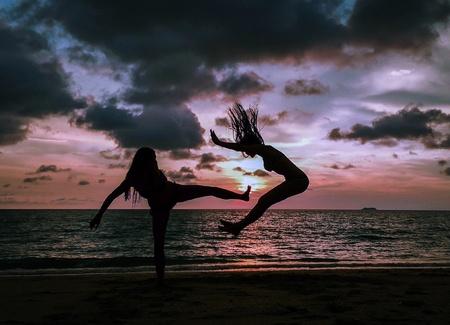 Kicking moment capturing of fun on sunset beach