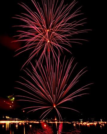 dark: Fireworks on dark night sky background Stock Photo