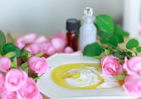 Group of pink roses, oil, lotion: spa treatment set Stock Photo