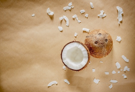 Coconut on natural brown background with copy space