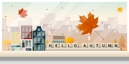 Letters spelling hello autumn on wooden table top