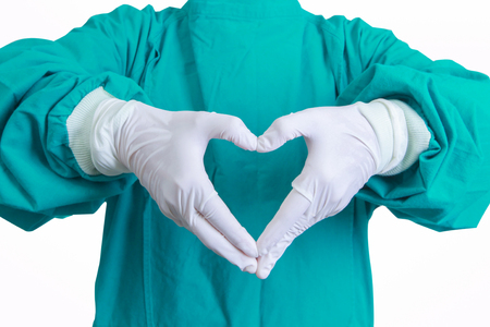 heart shape hands: Heart shape hands of surgeon doctor in the green gown on white blackground