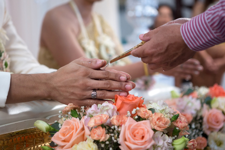 arm bouquet: Wedding of Thai woman and  foreign man Stock Photo