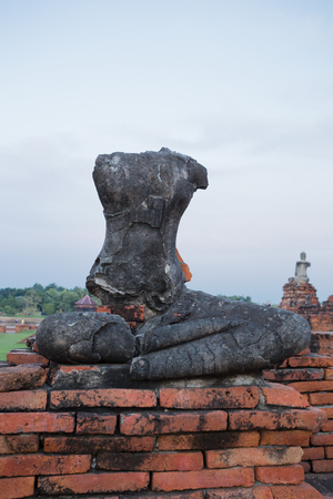 Broken Buddha statue at Ayutthaya historical park in Thailand