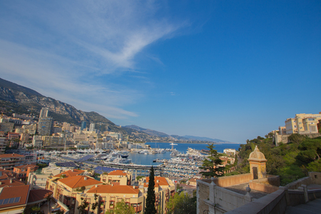 View of luxury yachts and architecture in harbor of Monaco
