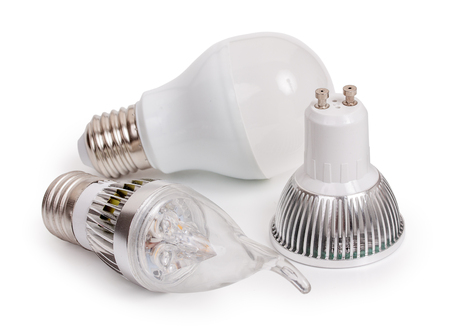 e27: Set of 3 energy saving LED light-emitting diode bulbs, with sockets type E27 and GU10  isolated on a white background, close up. Stock Photo