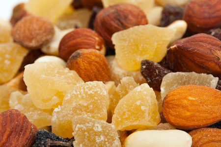 earthnut: Mixture of nuts and candied fruits isolated on a white background. Fruit Mix close-up.