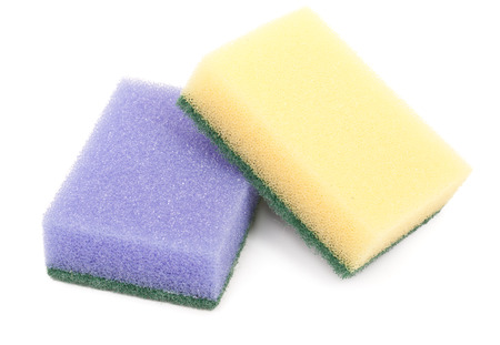 Sponges for washing and cleaning of kitchen ware, isolated on a white background. Stock Photo