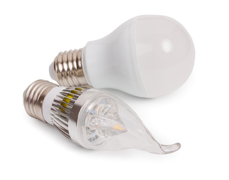 e27: Set of 2 energy saving LED light-emitting diode bulbs, with sockets type E27 isolated on a white background, close up.