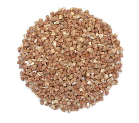 kasha: Grains of buckwheat  isolated on a white background. Top view.