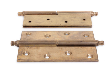 hinges: Pair of old hinges isolated on a white