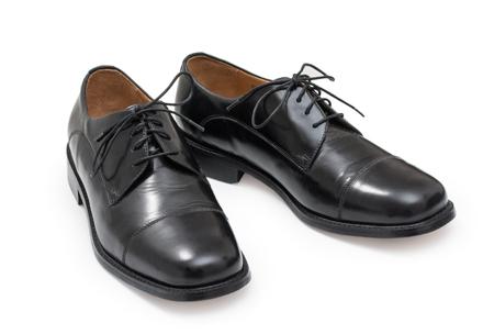 Pair of elegant mens shoes. Fashion black shiny leather. Isolated on a white background.