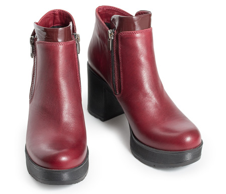 Pair of dark red womens leather boots isolated on a white background Stock Photo