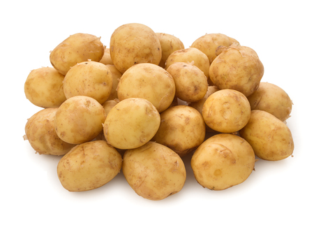 Heap of a new potato tubers isolated on white background.