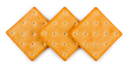 Three of crispy salted crackers isolated on a white background, top view, close up.
