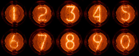 Nixie tube decimal digits. Set of real photos of very old, vintage indicator isolated on a black background.