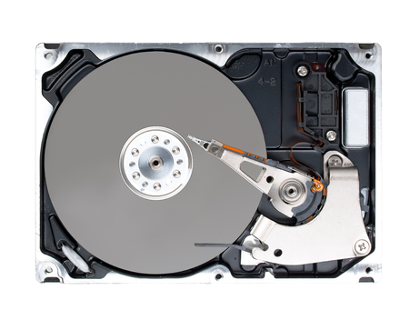 Computer hard disk drive (HDD) with opened cover isolated on white background. Top view, close up. Archivio Fotografico