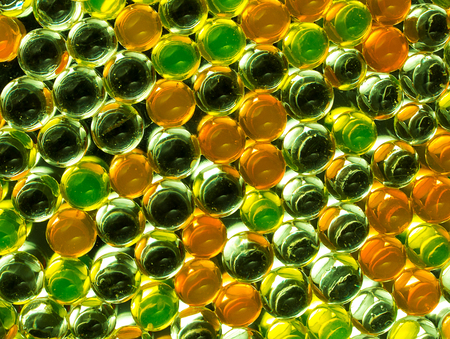 Bright, full color background of colored hydrogel balls.