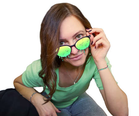 Female brunette caucasian model in sunglasses and green shirt. Melting lenses. 版權商用圖片