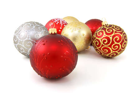Seven various glass christmas baubles on pure white background