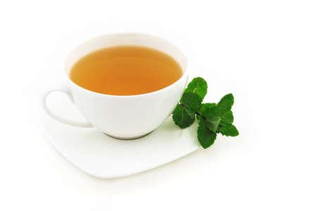 Hot mint tea on white background Stock Photo