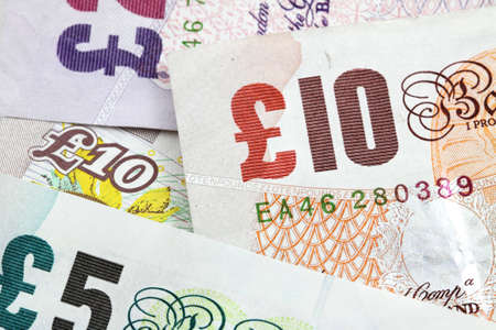 Several british banknotes as a money background Stock Photo