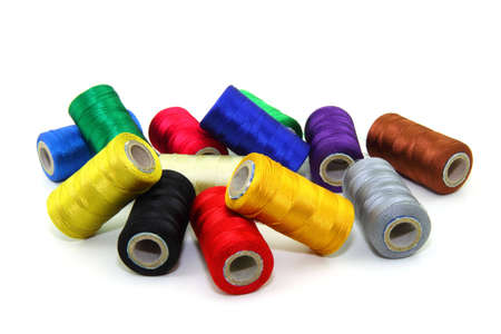 Colorful sewing threads on white background  Stock Photo