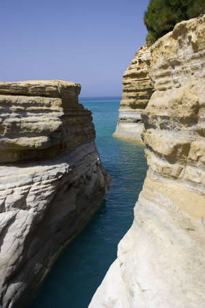 Limestone rocks on Corfu island with sea in the background Stock Photo