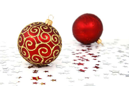 Two red christmas tree baubles with silver stars Stock Photo