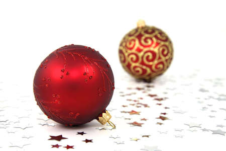 Two red christmas tree baubles with silver stars on white background Stock Photo