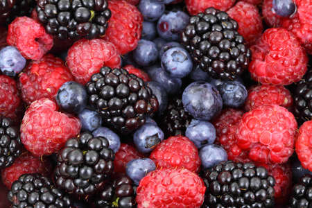 Mixture of forest fruit (blackberry, blueberry, raspberry) background Stock Photo