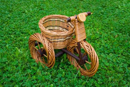 Wicker basket in motorcycle shape on fresh green grass