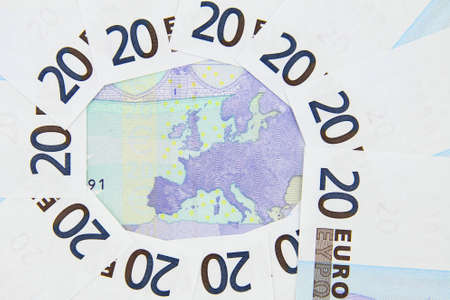 Europe map surrounded by 20 euro bank notes