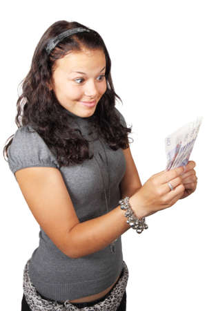 Young woman staring at money isolated on white background Stock Photo