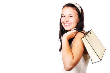 Jeune femme avec sac par-dessus son �paule isol� sur fond blanc