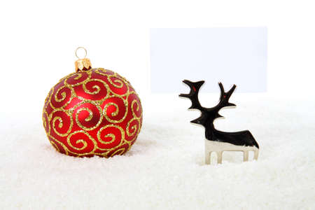 Reindeer holding business card with red bauble in snow on white background Stock Photo - 5932833