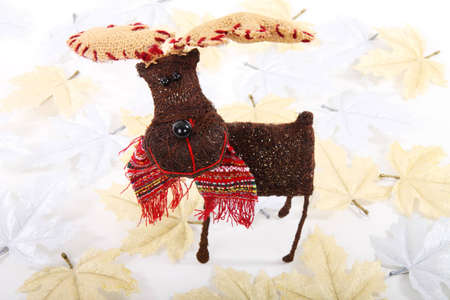 reindeer in silver and golden leaves