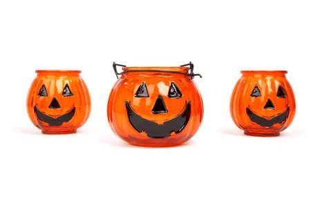 three Jack-o-lantern halloween candle holders isolated on white background